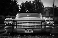 Cadillac Park Avenue (GnarlyRelics) Tags: auto park bw usa white black slr classic film car speed sedan 35mm vintage 50mm automobile texas olympus cadillac grill iso 200 transportation grille f18 avenue zuiko om1 grapevine cadi tarrant grapevinetx cadillacparkavenue