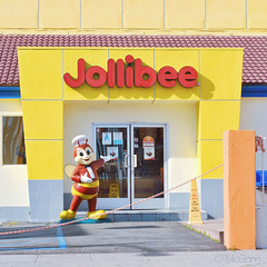 Jollibee (CPMcGann) Tags: california sunlight sunshine sign walking square losangeles interesting nikon bluesky hollywood signage jollibee cellphones walkinginla toeachother plasticsign walktalk crispychickenjoy juicyyumberger missingpersons1982