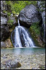 Enipeas Waterfalls (pap-x) Tags: park trees mist mountain snow green nature water beautiful rain clouds forest canon landscape waterfall rocks natural olympus greece enipeas