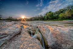 McKinney Falls State Park (Ellen Yeates) Tags: park sunset usa sun nature austin river landscape evening ellen waterfall bravo rocks texas state scene falls flare sunburst onion williamson creeks mckinney sunflare yeates ellenyeatesphotography