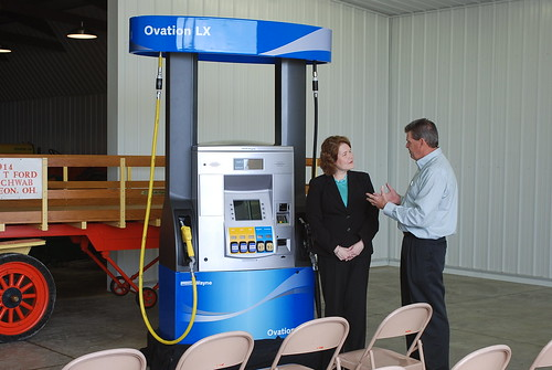 Judith Canales, USDA Rural Business-Cooperative Administrator is pictured with Glen Badenhop, co-owner of American Freedom Energy as he discusses a Flex-Fuel pump.