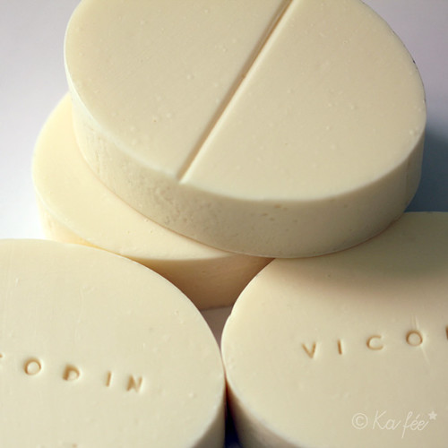 ivory coloured oval soaps. One side has a notch across to look like a notch in a halvable pill; the others side is stamped with VICODIN