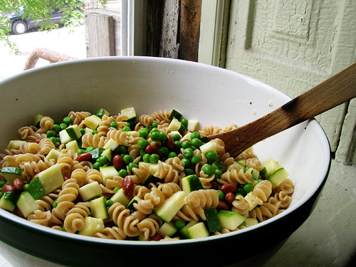 pasta salad with zucchini, red beans, and peas