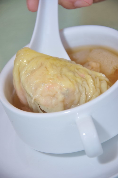 whole seafood dumpling served in superior stock