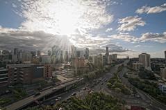 Brisbane City Skyline (BJRainbow) Tags: city sun holiday clouds cityscape australia 15 brisbane brisvegas qld queensland rays storybridge brisbanecity cityskyline kangaroopoint 15challengeswinner