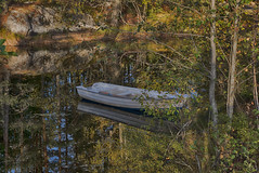 Boat on the lake (color) (la1cna) Tags: autumn hst walking hiking boat color woods lake landscape