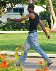 Johnny Walker (Legin_2009) Tags: road street flowers trees people man black male men guy grass walking skinny outside outdoors person persona belt slim arms exercise gente walk african sandals guys swing dude personas jeans mens flipflops tanktop males caribbean swinging persons armless dudes fitness slippers hombre fit hommes wifebeater männer homme hombres mec homens singlet homen muscleshirt mecs