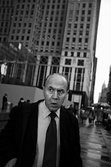Master of the Universe (syphlix) Tags: street nyc bw newyork apple businessman store nikon fuji manhattan candid stripes tie midtown suit scowl wallstreet nocrop tycoon 5thave finance tt5 pinstripes tt1 x100 sb28 pocketwizard
