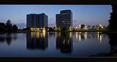 Glenwood Place - Overland Park (Subrat Pattnaik) Tags: longexposure blue panorama reflection building water fountain architecture night canon landscape eos evening pano reflect kansas overlandpark overland 60d