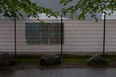 Being On An Outside (pni) Tags: street grass rain stone wall fence suomi finland poster evening leaf helsinki branch quiet pavement tent helsingfors kaisaniemi skrubu pni pekkanikrus kajsaniemi
