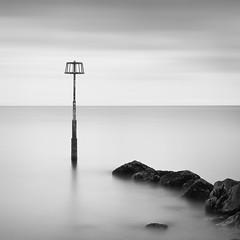 Amroth, Pembrokeshire (Weeman76) Tags: uk longexposure sea bw seascape monochrome wales mono nikon minimal le marker pembrokeshire minimalist amroth d90 markerpost nd110 niksoft silverefexpro2 sigma1770mmf284dcoshsm