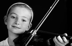 Alice with her Birthday Present from Granny (chrisps) Tags: birthday portrait music white black girl monochrome kids happy nikon play joy 85mm violin bow instrument present strings nikkor f14g d3x