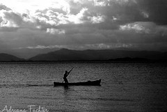 af0701_5106 (Adriana Fchter) Tags: ocean sea brazil bw praia beach sc brasil canon landscape boat mar fishing barco south artesanal culture ao florianopolis fisher santacatarina pesca catarina cultura sul canoa pescar