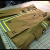 Custom Fireman's Kilt in bunker gear with support ribbon and embroidery. http://www.altkilt.com/fireman