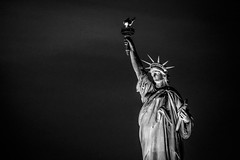 Statue of Liberty (M$ingh.) Tags: nyc newyorkcity winter bw white newyork black texture contrast canon liberty island eos rebel manhattan monotone statueofliberty libertyisland 650d t4i challengegamewinner