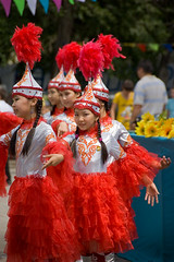 Street Dancers (berik) Tags: street girls red costume dancing hats dresses pigtails centralasia kazakhstan atyrau