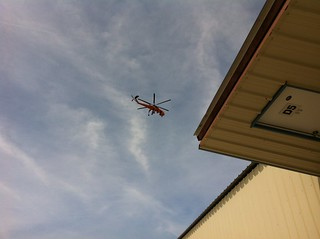 Erickson sky crane flying over the club hangar