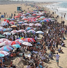 Huntington Beach, CA (Robert Borden) Tags: northamerica west westcoast california socal southerncalifornia huntington huntingtonbeach shore coast competition colors crowds people groupofpeople umbrellas water sea canon travel world sun surf