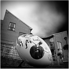 Rugby ball in Rugby (Jason 87030) Tags: football rugby town ragm artgallery museum building sport worldcup 2015 2016 art artistic sculpture balls artist black white blanc noir bw bbw square sony alpha nex ilce a6000 walk shops centre low pov perspective imagination sky dark september lunch camera angle kick players warwickshire event