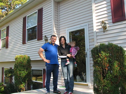 Mihai, Mihaiela, and Sabina Giurca in front of their new USDA-financed home in Egg Harbor Township, New Jersey