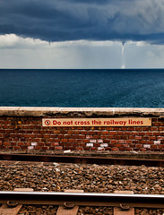 Italy - Cinque Terre: Danger (Nomadic Vision Photography) Tags: italy storm danger irony cinqueterre publictransport travelphotography tornadoe jonreid railwaylines tinareid httpnomadicvisioncom