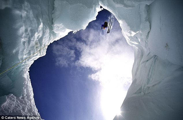 Going downhill... fast! Free skier takes amazing 600-feet leap off mountain cliff face  2