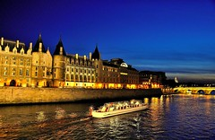 Architecture and reflections along River Seine (missgeok) Tags: lighting travel sky paris france architecture night buildings french outdoors lights boat mood nightlights colours nightscape bluesky illuminated clear romantic bluehour pontneuf gettyimages riverseine archbridge nightreflections wetreflections placeofinterest goldenreflections