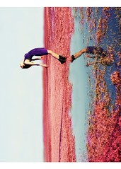 Candy Kisses on my Tongue (Of all the voices in my head) Tags: pink reflection water girl grass puddle unique rotation extraordinary picnik purpledress backbend pinkgrass imdoingtagsagainwhoo