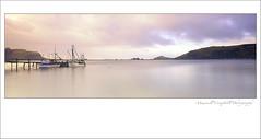 Serenity On The Lake (Maxwell Campbell) Tags: longexposure sunset newzealand panorama lake seascape mountains landscape boats south nz southisland otago dunedin trawlers