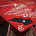 The NC State alma mater adorns a mortar board.