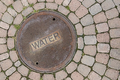 Water Manhole cover with brick (Guy dicarlo) Tags: manhole objectsequipment sewer architecturaldetail architectureandbuildings brick canal circle city cobblestone cover detail drain equipment floor hole industrialobjectsequipment iron lid manholecove metal objects pavement rain road round roundly rusty sewage sewerage sidewalk steel stone street tarmac urban waste water
