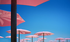 Sugar Beach (aaross) Tags: pink blue sky toronto fuji waterfront umbrellas x100 sugarbeach photogodfrey fujix100