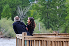 Couple on the Observation Deck Above the Clark Fork River, Downtown Missoula (CT Young) Tags: montana streetphotography missoula streetphoto gardencity caraspark streetcandid missoulamt clarkforkriver missoulamontana westernmontana downtownmissoula canonef70200mmf4lusm downtownriver downtownmissoulaclarkforkriver