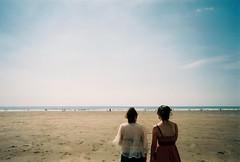 (sophie zurybida) Tags: summer analog 35mm coast seaside sand friendship happiness shore british puddles disposable