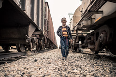 take the long way home (aamith) Tags: boy walking tracks trains boxcar nikond4 35mmf14g