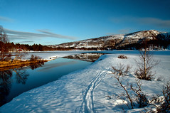 Spring is in the air (2Gry) Tags: blue sun white lake snow mountains nature norway reflections river landscape frozen spring melting day quiet riverside sunny calm norwegian scandinavia banks scandinavian skitracks