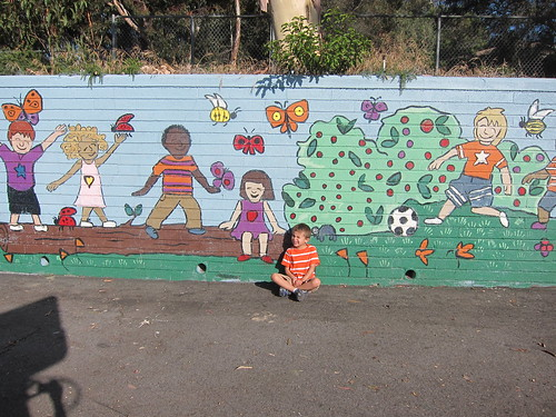 Ezra by the part of the mural he painted