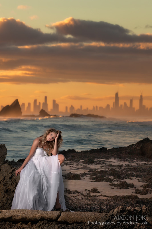 magda on the rocks with a beauty dish at sunset