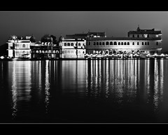 dreams are manifestations of reality.. (PNike (Prashanth Naik..back after ages)) Tags: longexposure bw india lake building history water architecture reflections lights hotel blackwhite nikon nightlights culture mahal palace reflect lakepalace rajasthan udaipur pichola d7000 pnike yahoo:yourpictures=blackandwhite