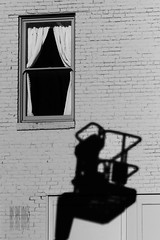 Shadow Escape (Ian Sane) Tags: street old city shadow urban white man black window wall oregon cherry ian photography alley downtown shadows escape basket lift crane curtain bricks images boom salem sane picker hydraladder