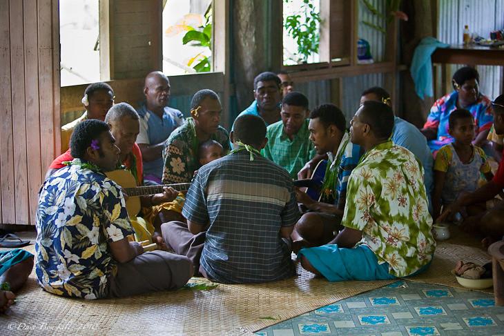 musicians play at fijian village kava ceremony