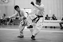 Karate Norgesmesterskap 2010 (Dmitry Valberg) Tags: woman white black cup girl oslo norway fight nikon norwegian karate combat 2010 highiso norges  12800 norgesmesterskap mesterskap d3s