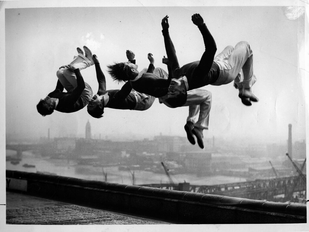 Photo used for show announcement (1935 (summer) unknown photographer for Associated Press London - The Four Trojans flipping on a rooftop)