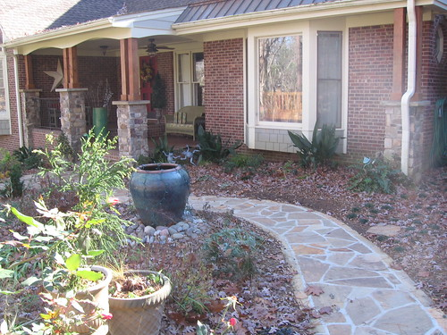 stone columns and flagstone walkway leading up to brick porch on a home in southwest Raleigh, North Carolina