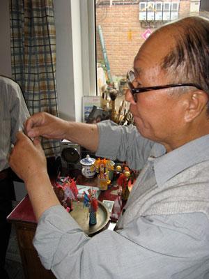 Artist working on dolls