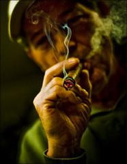 wisp (TheWalkinMan) Tags: portrait face dof smoke puff cigar tobacco wisp nikonsunglassesscoredatthethriftstore