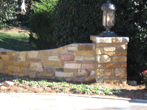 recent picture of left stone column with lamp in Raleigh, North Carolina