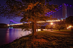 the George Washington Bridge (mudpig) Tags: park nyc newyorkcity longexposure bridge newyork reflection tree night geotagged newjersey purple manhattan lane hudsonriver gothamist georgewashington hdr gwb fortlee georgewashingtonbridge riverscape mudpig stevekelley