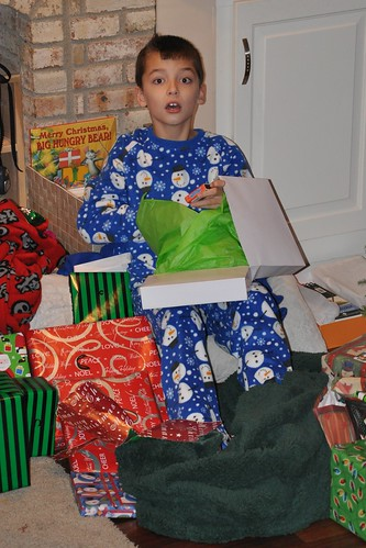 Carson Sits Atop a Throne of Gifts