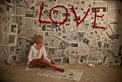 L O V E (III) (Emanuele Tagliaferri) Tags: italy muro art love girl beauty fashion wall paper newspaper blood glamour nikon solitude italia alone contemporaryart conceptual nikkor parete amore sangue giornali d80 1870dx